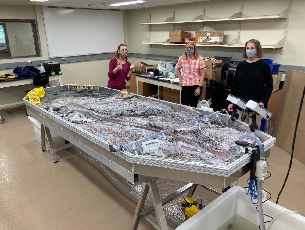 Professor Laura Triplett, lab assistant Morgan, and Professor Julie Bartley with their new Emriver Em4
